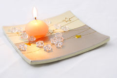 Candle with stars. On a decorative plate Royalty Free Stock Photography