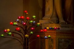 Candle stick tree in the church Stock Image