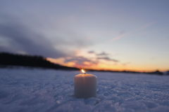 Candle sticking snow burning Royalty Free Stock Images