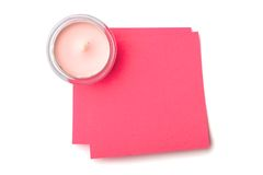 Candle and sticky note Stock Images