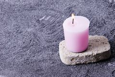 Candle on Stone Royalty Free Stock Images