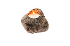 Candle in stone on a white background Royalty Free Stock Photos