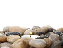 Candle  in stones Stock Photography