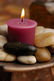 Candle with Stones stock image
