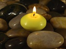 Candle on Stones Royalty Free Stock Image