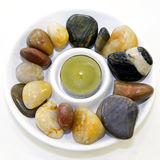 Candle and stones Royalty Free Stock Photos