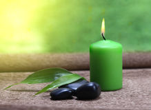Candle, stones and leaf Royalty Free Stock Images