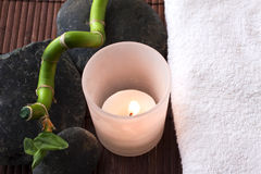 Candle, stones and towel Stock Images