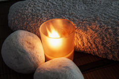 Candle and stones Stock Photography