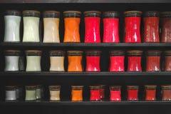 Candle store scented candles shelves black background shelf matt. E Stock Photo