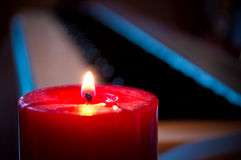 Candle and synthesizer Stock Images