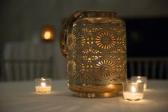 Candle. Table candle with ornamental holes stock photo