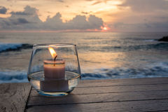 Candle on a table at sunset view cafe, at Sunset Point, Nusa Lembongan, Indonesia Stock Photos