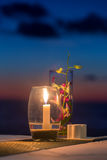 Candle on a table at sunset view restaurant on Koh Kood island Stock Photos
