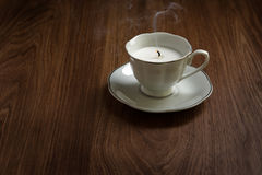 Candle in a tea cups Stock Images