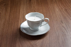Candle in a tea cups Royalty Free Stock Image