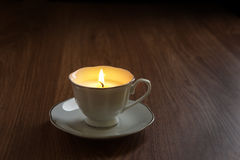 Candle in a tea cups Stock Photos