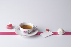 Candle, tea, love note and cookie Royalty Free Stock Photography