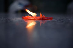 Candle in a temple. A candle is burning out Royalty Free Stock Photos