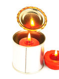 Candle on a tin can. Red candle on a tin can over white background Royalty Free Stock Images