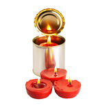 Candle on a tin can. Red candle on a tin can over white background Royalty Free Stock Image