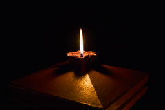 The candle. To light in the darkness Royalty Free Stock Photo