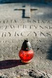 A candle on the tombstones Royalty Free Stock Image