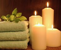 Candle and towel Royalty Free Stock Images