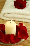 Candle, towel and petals of  rose. Stock Photography