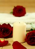Candle, towel and red roses. Stock Images