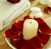 Candle, towel, stones and petals of  rose Stock Photo
