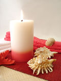 Candle, towels and seashells Royalty Free Stock Image