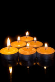 Candle triangle on a black background Royalty Free Stock Photos