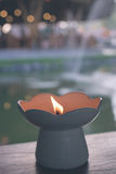 Candle on tropical lake background, spa concept, Bali island, Indonesia. stock photo