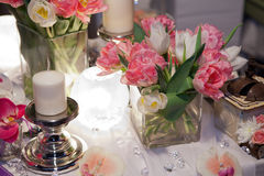 Candle and tulips Royalty Free Stock Photo