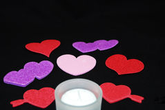 Candle with valentine hearts Royalty Free Stock Photography