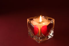 Candle with valentines on the red background Royalty Free Stock Image