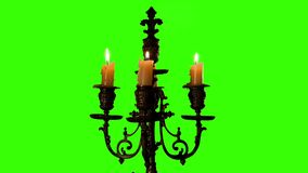 Candle in vintage candlestick on green screen stock footage
