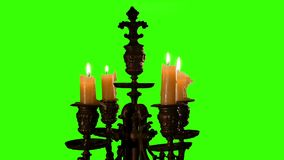 Candle in vintage candlestick on green screen stock video footage