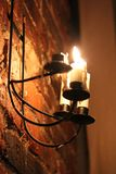 Candle on wall night time black and dark Royalty Free Stock Image