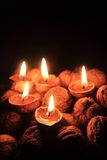 Candle from the walnut shells - christmas tradition Royalty Free Stock Photos