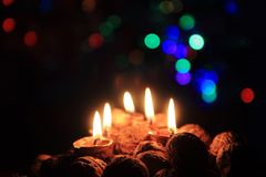 Candle from the walnut shells - christmas tradition Stock Photography