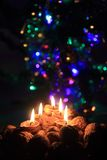 Candle from the walnut shells - christmas tradition Stock Image