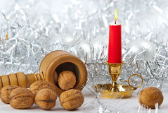 Candle and walnuts. Christmas still life with candle and walnuts stock image