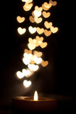 Candle warmth. Candle and hearts for a peaceful night Royalty Free Stock Photo