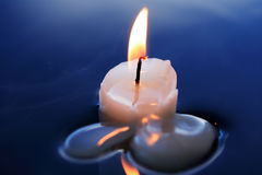 Candle On Water Stock Photo