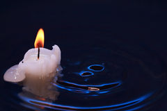 Candle In Water Stock Images