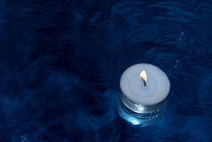 Candle on water Stock Images