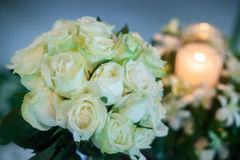 Candle and Wedding bouquet of white roses Royalty Free Stock Image