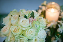 Candle and Wedding bouquet of white roses Royalty Free Stock Photography